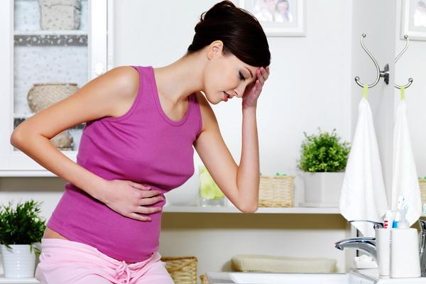 Основная причина боли в животе при беременности